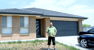 Photo of HashChing customer Simon in front of his home